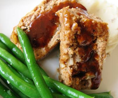 Meatloaf, green beans, and mashed potatoes on a plate